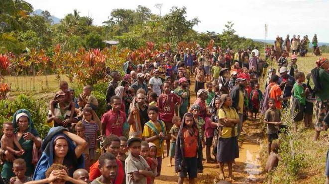 Locals at the Huya airstrip