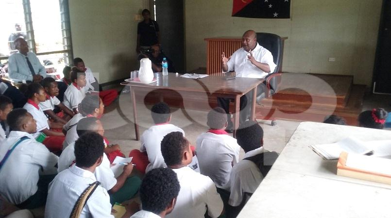 Students listening to Justice Mogish during the court user forum in Bereina, Central Province.