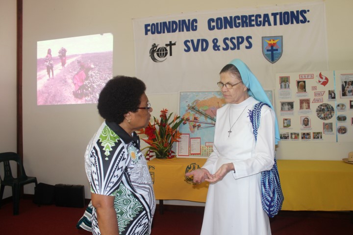 01.	One of the Catholic missionaries serving in DWU, Associate Professor Sister Miriam Dlugosz PhD (right) with DWU President Professor Cecilia Nembou PhD at the display area of the Mission and Identity Directorate on Open Day. Photo by Dr KEVIN PAMBA