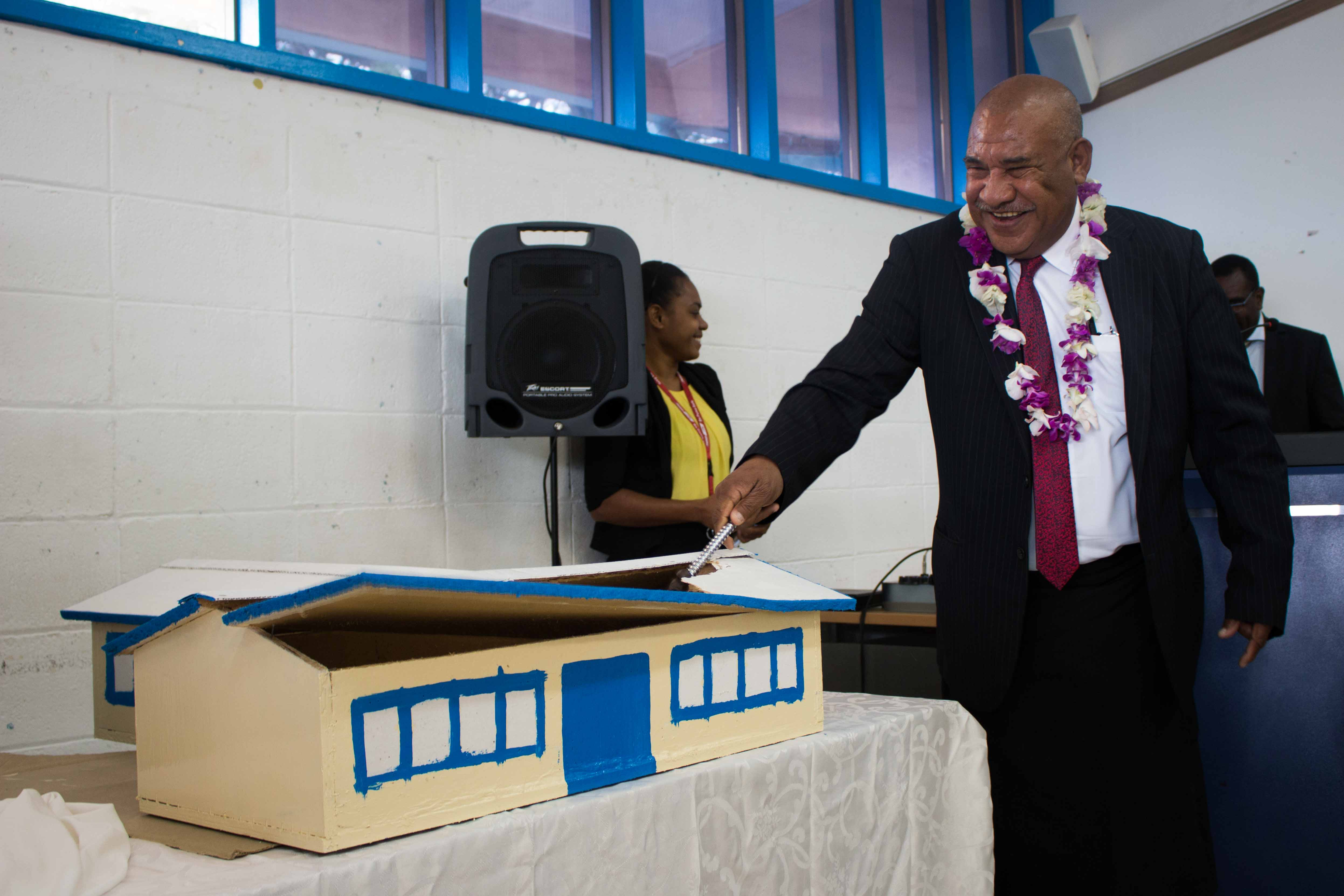 DPM Secretary Kali symbolically demolished a model of the old PNGIPA Library that is to be replaced