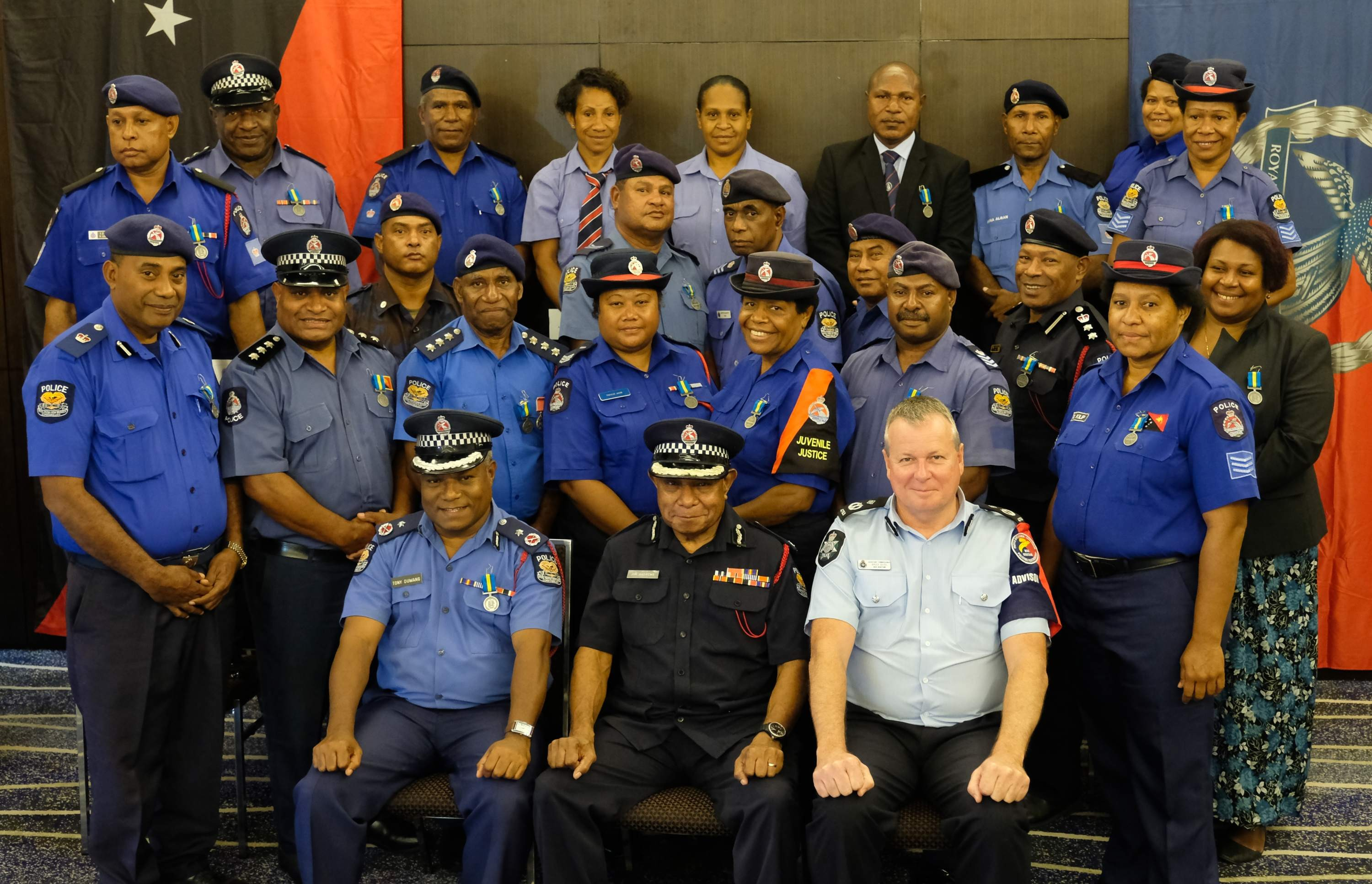 Seated from left is Assistant Commissioner of Police Logistics Tonny Duwang, Deputy Commissioner of Police and Chief of Operations Jim Andrews and Mission Commander of the PNG-Australia Policing Partnership Assistant Commissioner of Police Bruce Giles with the recipients of the  Royal Solomon Islands Police's International Law Enforcement Cooperation Medal at the Stanley Hotel in Port Moresby on Monday, Aug 13