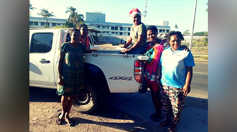 Out on the streets of Port Moresby - Taku family