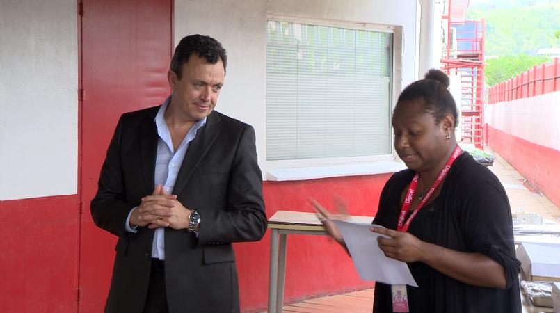 Digicel PNG CEO, Valde Ferradaz, with a member of Digicel's social committee, Jessica Satbah