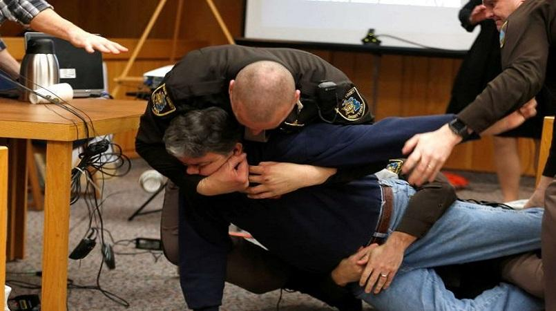 Nassar hearing halted as victims' father lunges at disgraced doctor