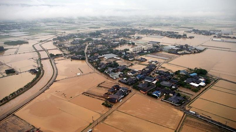 Rescuers scramble after flash floods sweep parts of south Japan