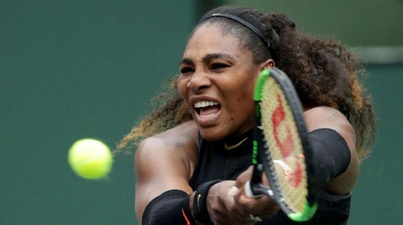 Serena sets up showdown with sister