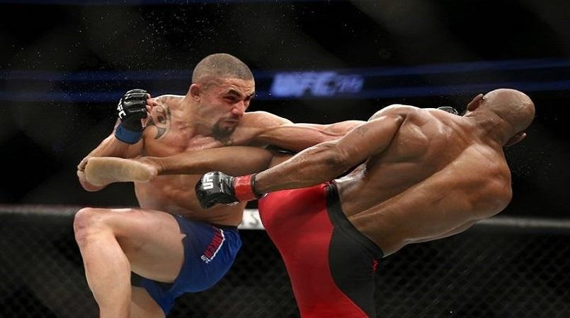 UFC 213: Whittaker outlasts Romero to become Australasia's first UFC Champion