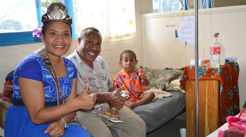 Grace Nugi with patient at Goroka Hospital