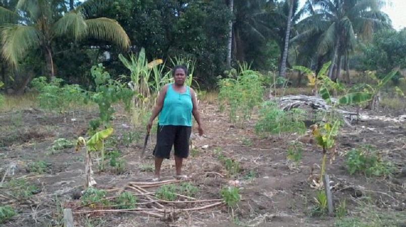 woman from Pinu village in her garden