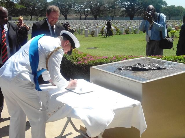 His Royal Highness Prince Andrew signs visitors book at Bomana War Cemetery