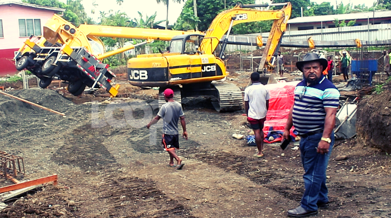 Property manager of Premium Builders, Peter Andita, showing media the construction site