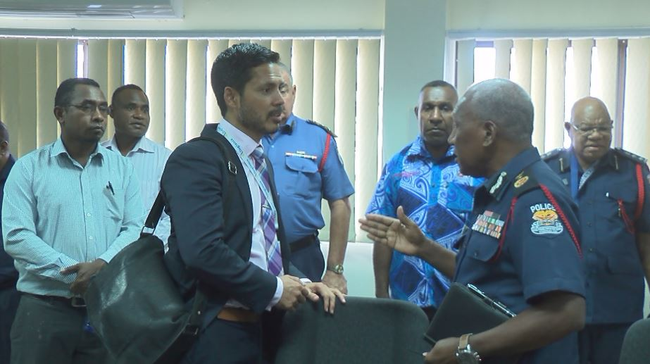 Police Minister Bryan Kramer chatting with Commissioner Baki after the briefing