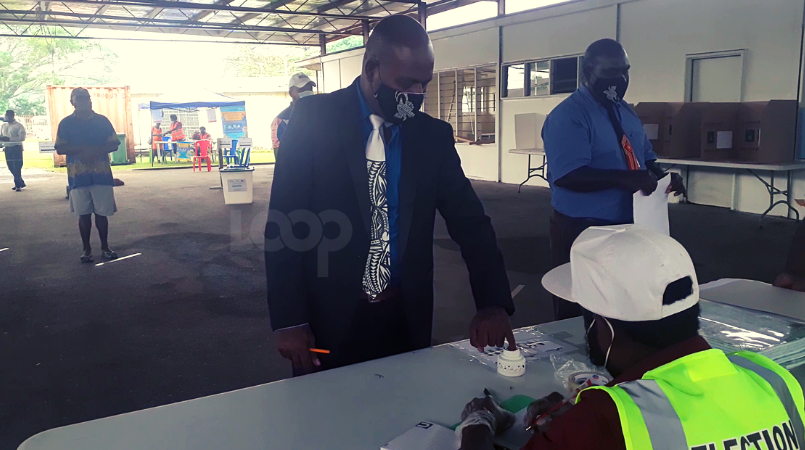Morobe Province Election Manager, Simon Soheke, placing his finger into indelible ink, commonly known as voters' ink
